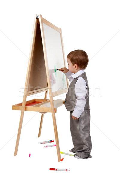 A child paints on an easel in the studio Stock photo © RuslanOmega