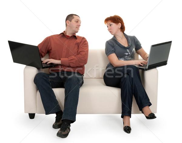 Marido esposa sesión sofá laptops hombre Foto stock © RuslanOmega