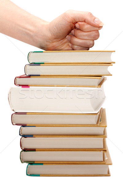 Feminine fist on pile of the books Stock photo © RuslanOmega