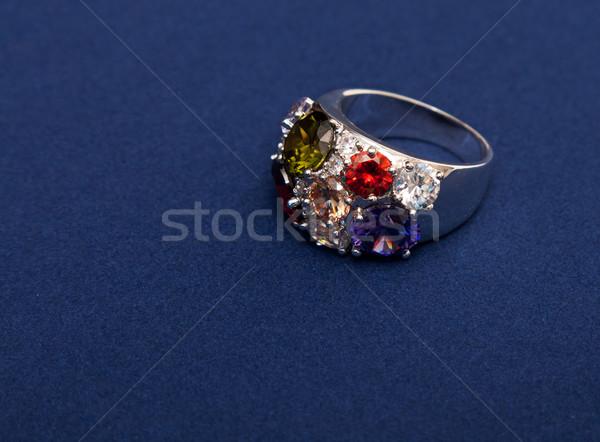 Zilver ring gekleurd stenen Blauw achtergrond Stockfoto © RuslanOmega