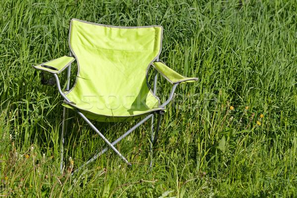 Green folding chair on the grass Stock photo © RuslanOmega