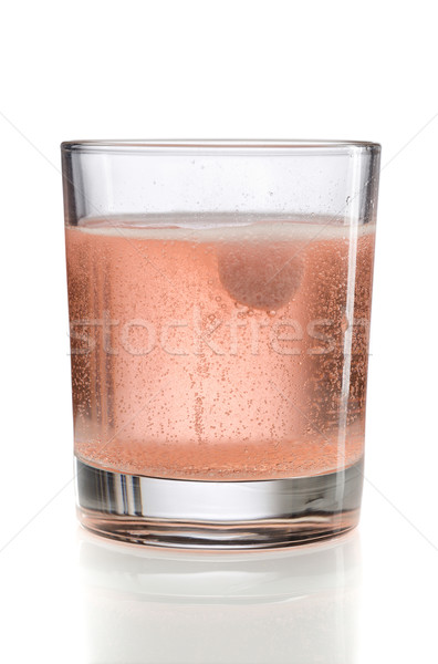 Orange effervescent tablet in a glass of water. Stock photo © RuslanOmega