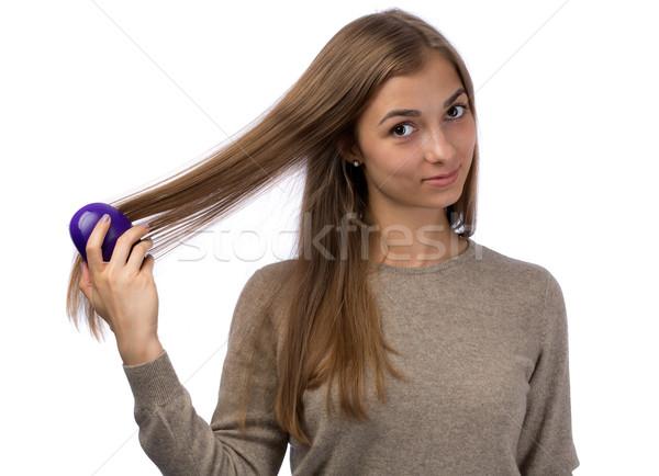 girl combing Stock photo © RuslanOmega