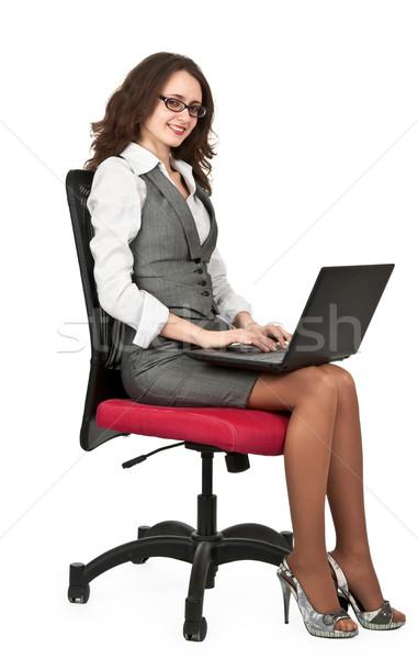 Business bruna ragazza sedia laptop bianco Foto d'archivio © RuslanOmega