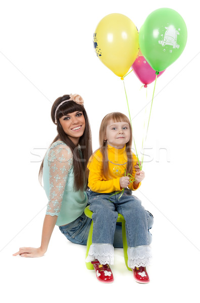 studio shot of mother and daughter with balloons Stock photo © RuslanOmega