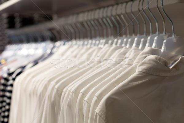 Whine Fashionable clothes on hangers Stock photo © RuslanOmega