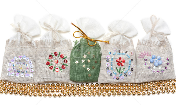 Bags with spice and golden necklace Stock photo © RuslanOmega