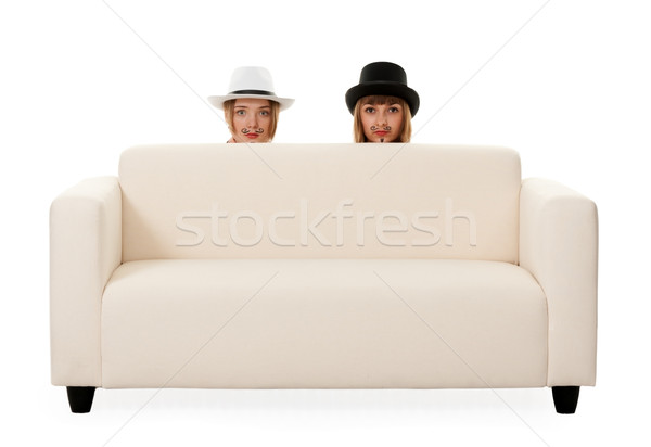 Two girls on the couch Stock photo © RuslanOmega