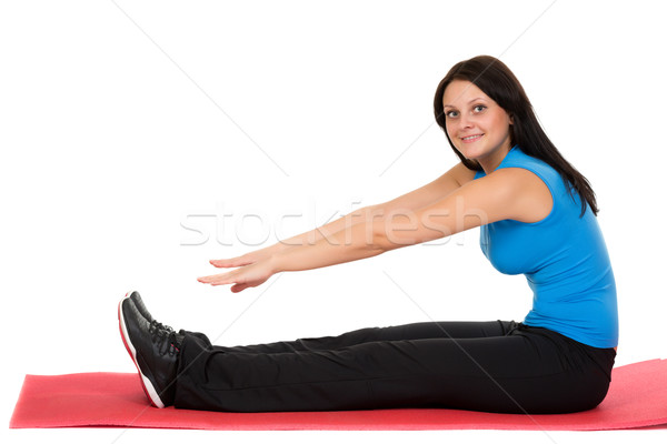 Young beautiful girl sitting on a yoga mat Stock photo © RuslanOmega