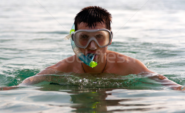 The man in the sea in a mask Stock photo © RuslanOmega
