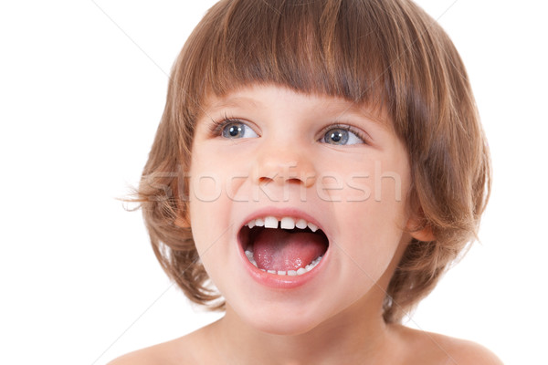 Stock photo: Studio portrait of a close-up of a girl with her mouth open with