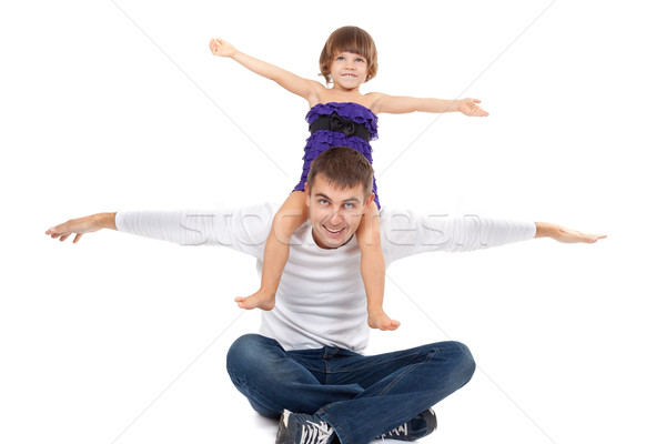 Stock photo: Handsome father with his little daughter on his shoulders happil