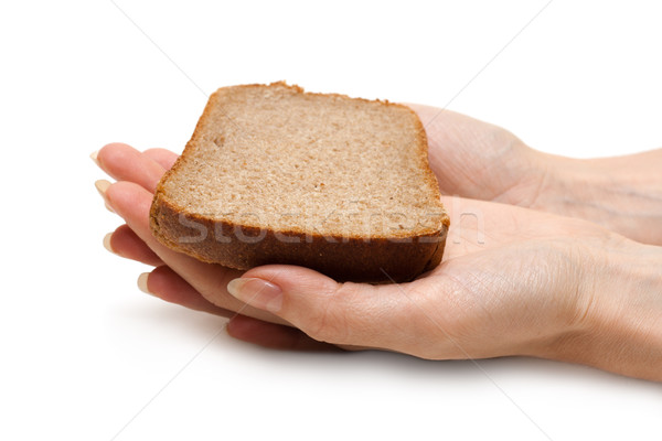 Piece of the pumpernickel in woman hands Stock photo © RuslanOmega