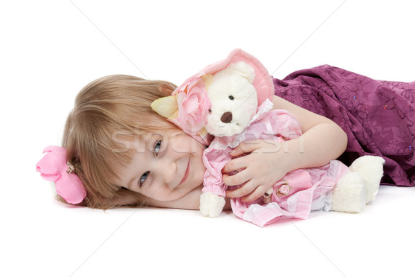 a little girl 4 years old with a plush toy bear Stock photo © RuslanOmega