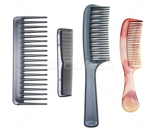 Four plastic combs Stock photo © RuslanOmega