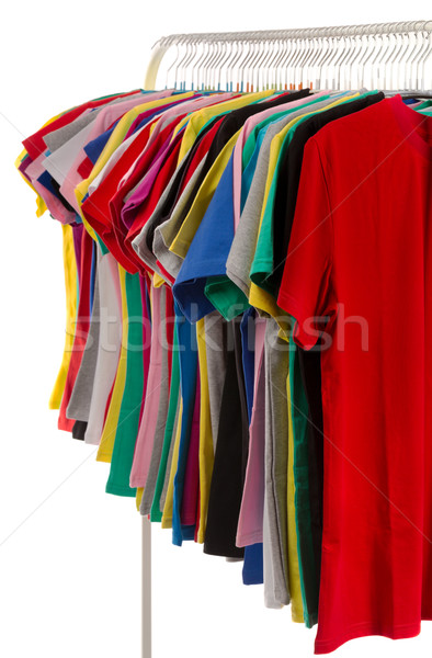 Colored shirts on hangers in a row. Stock photo © RuslanOmega