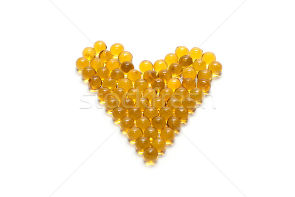 Disposit of the capsules cod-liver oil insulated on white backgr Stock photo © RuslanOmega