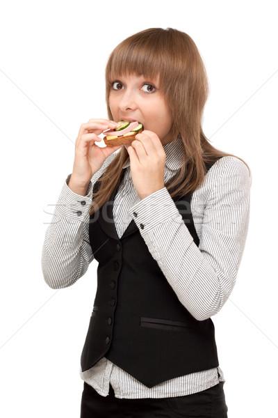 Fiatal lány szendvics kolbász uborka nő étel Stock fotó © RuslanOmega