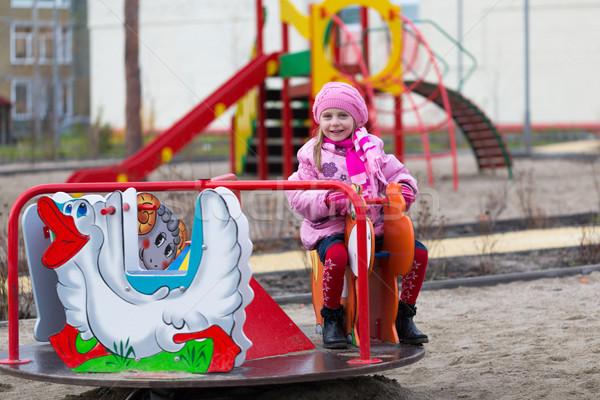 Lány körhinta kislány ősz ruházat sportok Stock fotó © RuslanOmega
