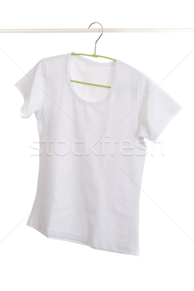 Stock photo: white t-shirt on hanger.