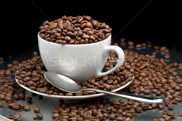 Tasse soucoupe plein grains de café cuillère noir Photo stock © RuslanOmega