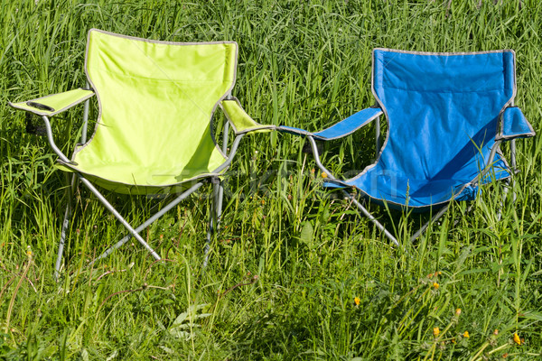 Two empty folding chair on the green grass Stock photo © RuslanOmega