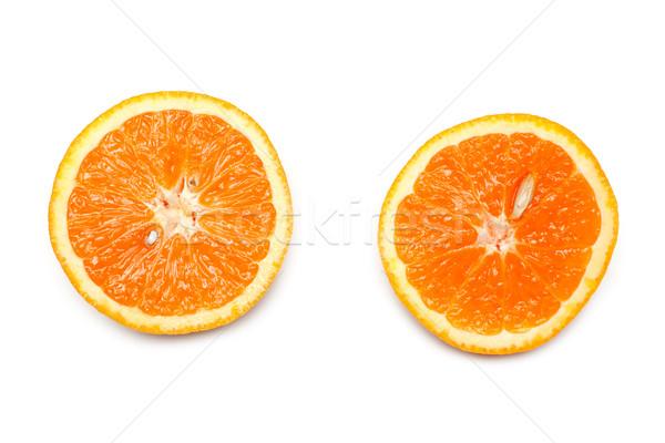Two cut on fifty-fifty orange Stock photo © RuslanOmega