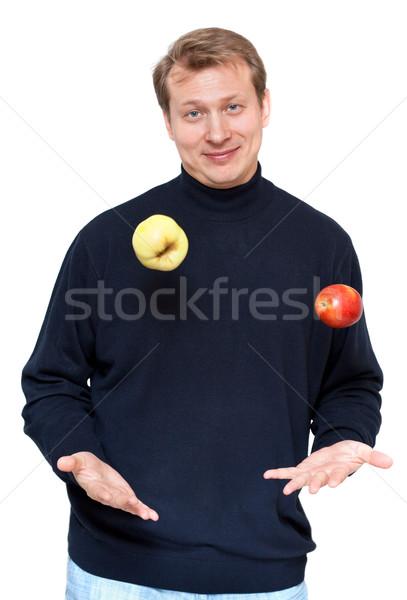 Man in dark cloth juggle apple Stock photo © RuslanOmega