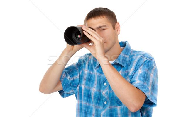 Jóképű fiatalember tart kameralencse ahogy néz Stock fotó © RuslanOmega