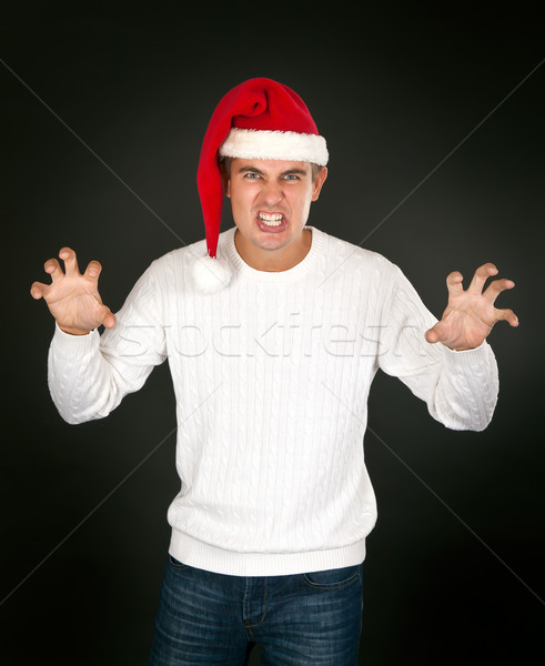 man in the bell Santa's face shows terrible Stock photo © RuslanOmega