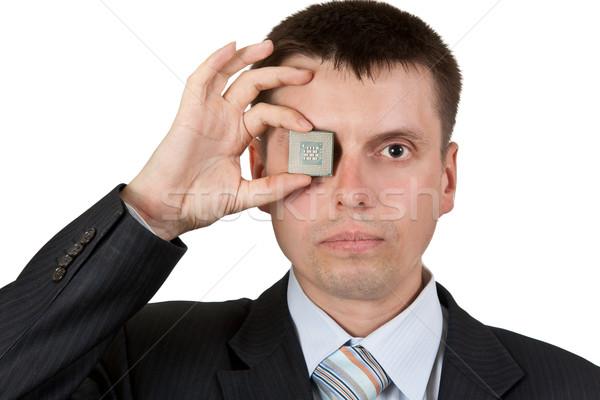 Businessman closes one eye, a processor Stock photo © RuslanOmega