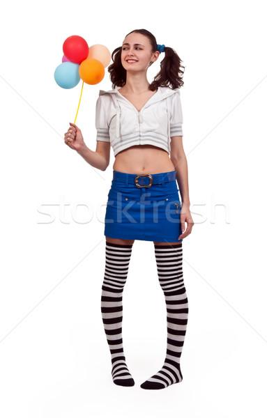 Lány csíkos zokni miniszoknya léggömbök nő Stock fotó © RuslanOmega