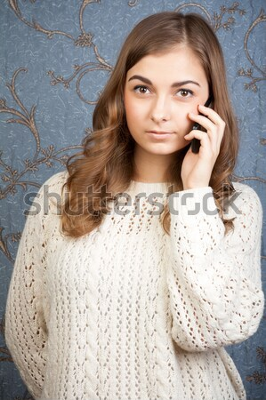 Woman talking on the phone on the background of the retro patter Stock photo © RuslanOmega
