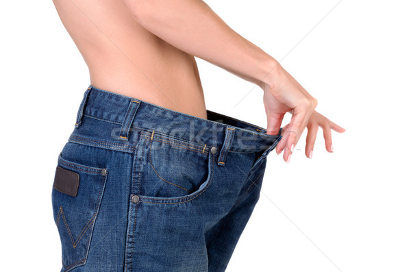 slim girl in big jeans Stock photo © RuslanOmega