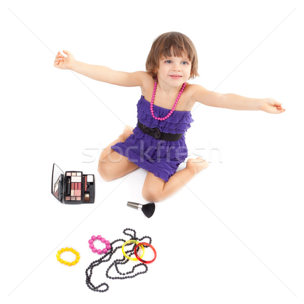 Cute little girl with makeup, necklaces and bracelets is in adul Stock photo © RuslanOmega