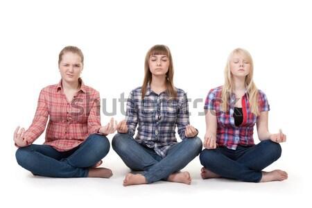 Three girls sitting in lotus posture Stock photo © RuslanOmega