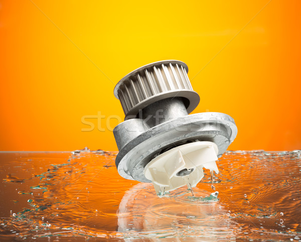 Auto parts, engine cooling pump in water splash on orange gradie Stock photo © RuslanOmega