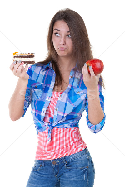 Girl in doubt with an apple and a cake Stock photo © RuslanOmega