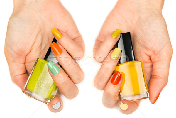 Women's hands with a colored nail varnish Stock photo © RuslanOmega