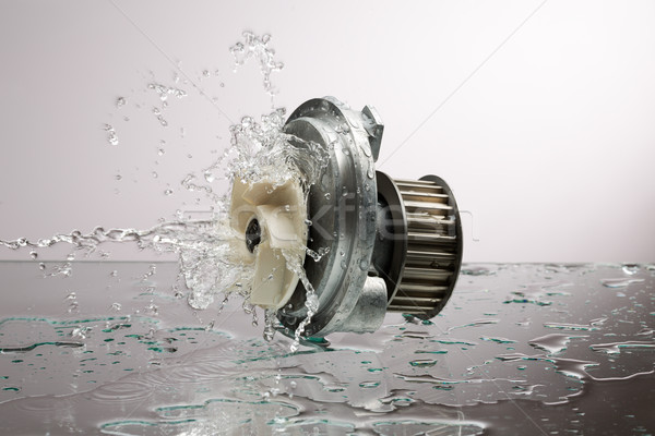Auto parts, engine cooling pump in water splash Stock photo © RuslanOmega