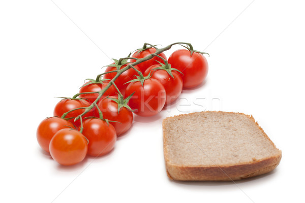 Red tomatoes cherry, pumpernickel two Stock photo © RuslanOmega