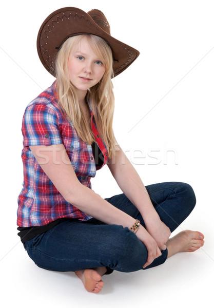 Beautiful girl chapéu de cowboy sessão lótus posição mulher Foto stock © RuslanOmega