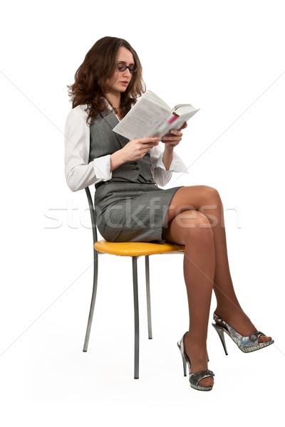 Ragazza seduta sedia lettura libro bruna Foto d'archivio © RuslanOmega