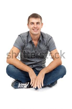 Casual homem sessão lótus posição sorridente Foto stock © RuslanOmega
