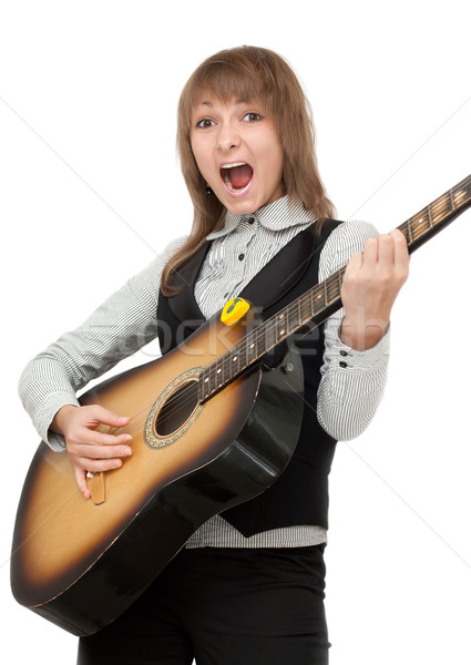 Girl with guitar in hand expressive sings Stock photo © RuslanOmega