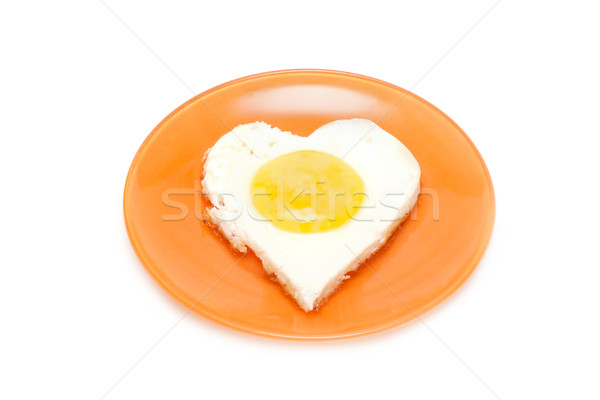 Fried egg in form heart on plate Stock photo © RuslanOmega