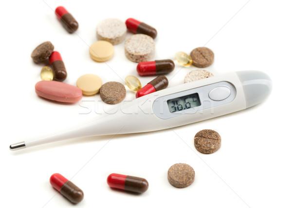 Eletrônico termômetro pílulas branco médico Foto stock © RuslanOmega