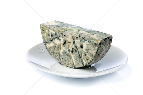 Cheese with mold on the plate. Isolate on white. Stock photo © RuslanOmega