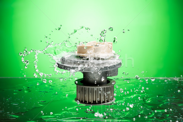 Auto parts, engine cooling pump in water splash on green backgro Stock photo © RuslanOmega