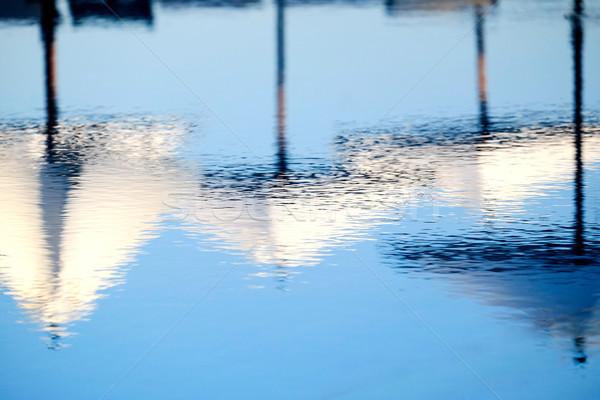 Parapluies réflexion soleil piscine eau Photo stock © russwitherington